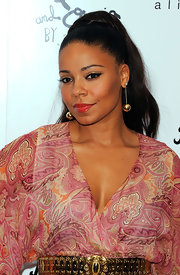 Sanaa Lathan paired her sleek ponytail with dangling gold earrings.