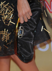 Eva donned an elegant gemstone encrusted clutch while walking the red carpet. The added jewels were a great way to bring interest to the bag.