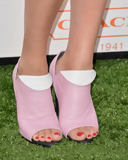 Chloe Sevigny showed off her red pedicure with these pastel pink peep-toe ankle booties.