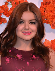 Ariel Winter chose a hot pink lip color to bring out the fuchsia in her cocktail dress.