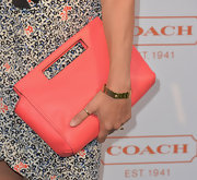 Chloe Sevigny paired a coral bag with her floral frock to add just a touch of springtime color.