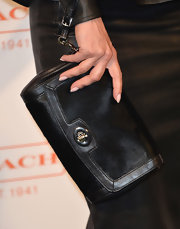 Mena Suvari chose an all-black look even down to her clutch, which was a black leather piece.