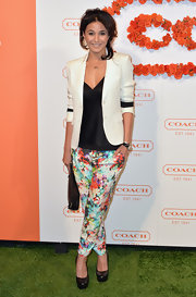 Emmanuelle Chriqui looked sleek and sophisticated in this white blazer that featured black stripes on the sleeves.