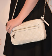 Michelle Trachtenberg chose a classic leather chain strap bag for her look at Coach's CDF event.