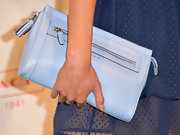 Jurnee Smollett chose an oversized lavender clutch to complement her blue frock at the Coach CDF benefit.