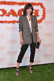 Milla Jovovich stuck to her structured and chic look with this oversized blazker.