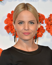 Mena Suvari swept her hair back into a sleek ponytail with a center part for a chic and classy evening 'do.