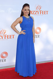 Sharna Burgess' royal blue gown featured elegant draping that just glided on the red carpet.