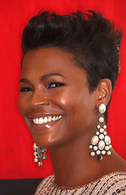 Nia was all smiles as she showed off her pearl embellished earrings.