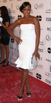 Tichina Arnold went for subtle elegance at the Essence Black Women in Hollywood Luncheon with a strapless little white dress featuring an ultra-feminine flared hem.