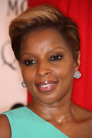 Mary J. finished off her shirt haircut with cluster diamond earrings.
