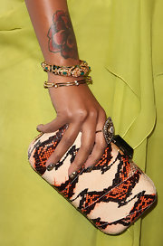 Eve stepped up the glam with some luxe bangle bracelets.