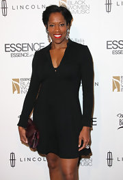 Regina King complemented her LBD with a chic snakeskin clutch when she attended the Black Women in Music event.