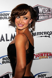 Karina Smirnoff paired her sexy lace dress with pinned up ringlets.