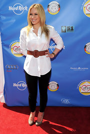 The actress cinched her waistline with a large brown leather belt over a menswear-inspired button-up shirt.