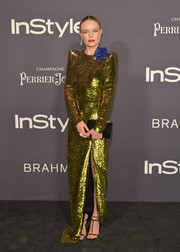 Kate Bosworth polished off her look with a black velvet clutch, also by Christian Louboutin.