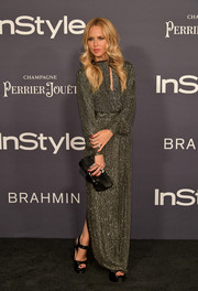 Rachel Zoe paired her dress with towering platform sandals.