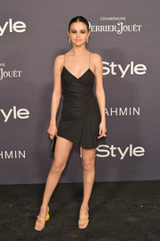 Selena Gomez went for playful styling with a pair of quirky-heeled strappy sandals, also by Jacquemus.