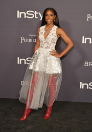Kelly Rowland gave her romantic dress an edgy punch with a pair of red thigh-high boots by Fendi.