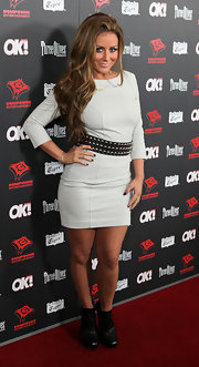 Aubrey rocked out her grey mini dress with a chunky, silver studded belt.