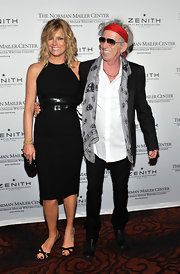Patti Hansen accessorized her black dress with a pair of matching black slingback evening sandals.
