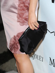 Mena made a bold pairing by opting for a stain black clutch to complement her blush colored dress.