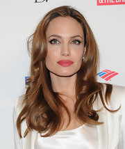 Angelina Jolie attended the 3rd Annual Women in the World Summit wearing a dark pearly pink lipstick.