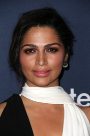 Camila Alves styled her tresses into a messy-sexy updo for the unite4:humanity event.