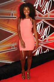 K. Foxx chose a pretty pink bandage dress for her look at the 40/40 Club Anniversary Party.