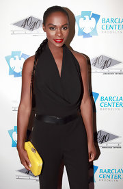 Tika Sumpter's yellow hard-case clutch was a bright finish to her look during the 40/40 Club grand opening.