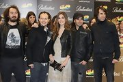 Leira Martinez was spotted at the '40 Principales Awards 2011' carrying a buckled leather purse.