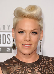 Even through Pink traded in her signature punk style for ladylike dress at the 2012 AMA, she still showed off her rocker ways with this gorgeous retro 'do.
