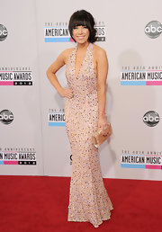 Carly Rae Jepsen dazzled in a beautifully-beaded blush-hued halter dress at the 40th American Music Awards.
