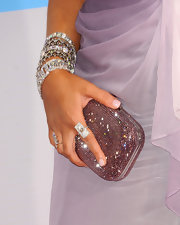 Christina's shimmering clutch was the perfect complement to her dazzling ombre gown.