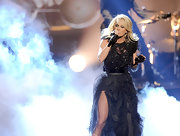 Carrie Underwood exuded gothic romance on-stage at the 40th Annual AMAs in a deconstructed tulle dress with dazzling crystal detailing.