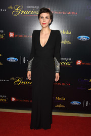 Maggie Gyllenhaal's low-cut black Alexander McQueen gown at the Gracies Awards oozed sex appeal without showing too much skin.