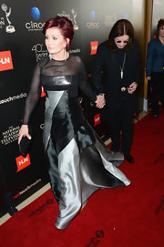 Sharon Osbourne attended the 40th Daytime Emmy Awards wearing an elegant color-block gown with sheer chiffon sleeves.