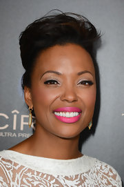 Aisha's bright pink lips added a splash of color to her bold look at the Daytime Emmy Awards.