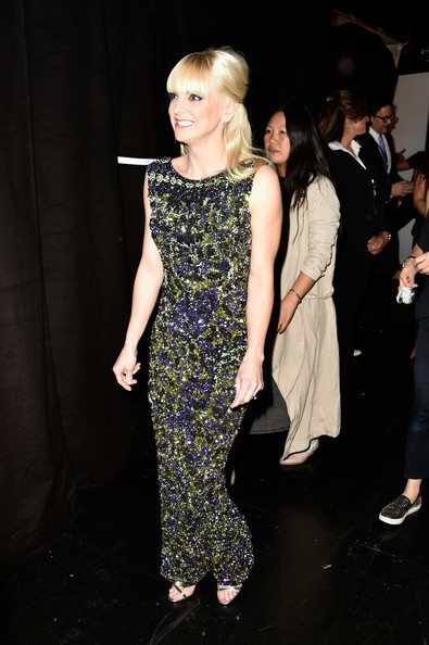 Anna Faris was photographed backstage at the People's Choice Awards looking all sparkly in a fully beaded green and purple gown.