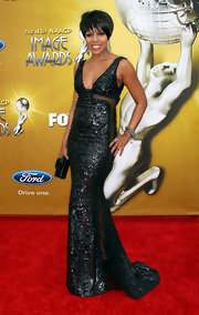 Wendy Raquel Robinson mixed glamour with sexiness in a black sequined gown with see-through panels down the sides.