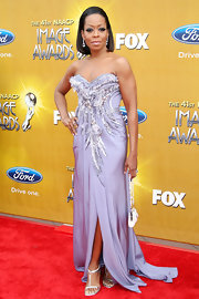 Tichina Arnold sparkled in an embellished evening dress and silver T-strap sandals at the NAACP Image Awards.