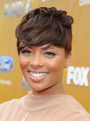 America's Next Top Model Winner Eva Marcille, smiled as she showed off her cropped brunette tresses.