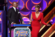 TV personality Steve Harvey (L) and host Tyra Banks speak onstage during The 42nd Annual Daytime Emmy Awards at Warner Bros. Studios on April 26, 2015 in Burbank, California.