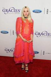 Dove Cameron drowned her figure in an oversized color-block lace dress by Bora Aksu at the Gracie Awards.
