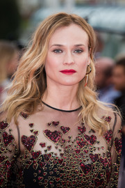 Diane Kruger finished off her look with a standout red lip.