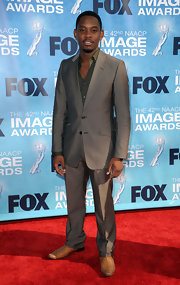 Aml Ameen rocked a gray suit while attending the 42nd NAACP Image Awards.