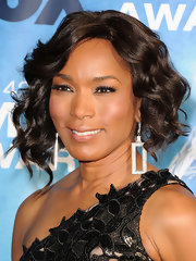 Angela Bassett added a little drama to her look with fluttering lashes.