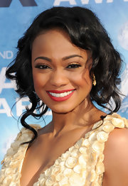 Tatyana Ali added a ravishing touch to her look with sultry red lipstick at the NAACP Awards.