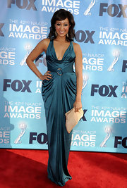 Tamera Mowry accented her jewel-toned dress with a light neutral clutch at the 2011 NAACP Image Awards.