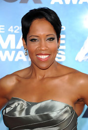 Regina King amped up her look with silver metallic shadow, which was the perfect match for her satin dress.